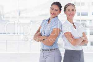 Businesswomen standing back to back