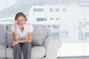 Businesswoman getting headhache