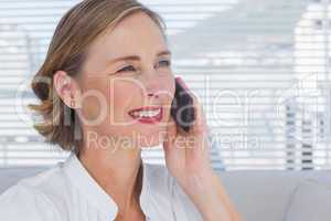 Portrait of businesswoman calling in a bright office