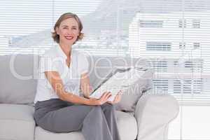 Businesswoman holding newspaper