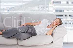 Businesswoman lying on couch