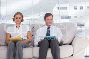Two business people sitting on couch