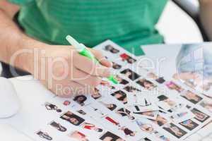 Photo editor marking contact photographs