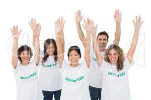 Group of volunteers raising arms