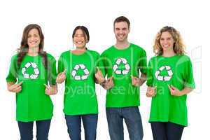 Group of environmental activists pointing their tshirt