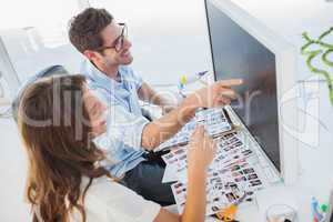Attractive photo editors working on computer