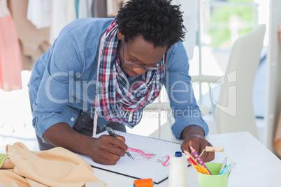 Fashion designer drawing woman clothes