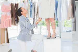 Designer adjusting dress