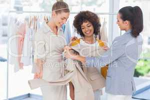Fashion designers looking at a blazer