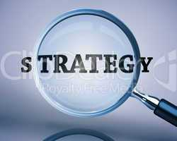 Magnifying glass showing strategy word