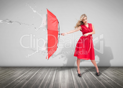 Attractive woman holding an umbrella to protect herself from the