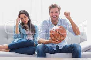 Woman annoyed by her partner watching basketball game
