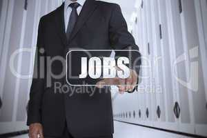 Businessman in a data center selecting label with jobs