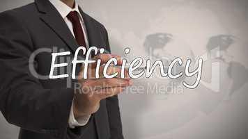 Businessman writing the word efficiency