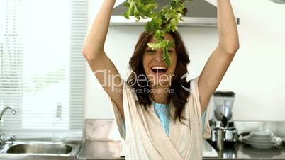 Woman lets fall lettuce while preparing a salad
