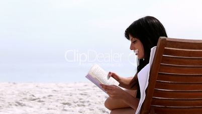 Brunette reading a book