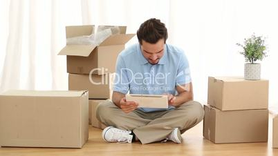 Man using digital tablet in his living room