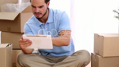 Man using a tablet in his living room