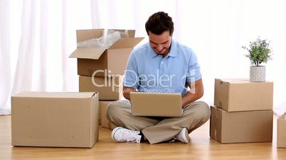 Man using his laptop in his living room