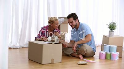 Couple discuss the colour of their living room
