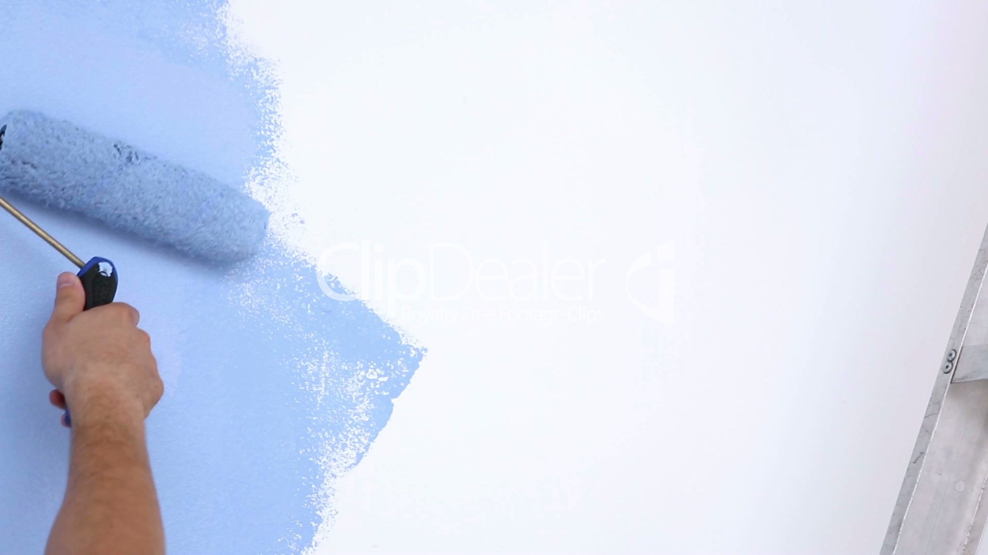 painting a wallMan painting a wall in blue Royaltyfree video and stock footage