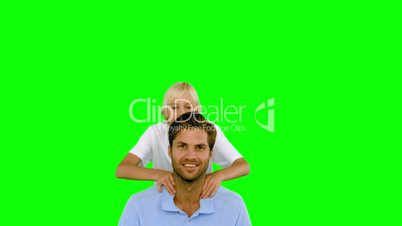 Son jumping on his fathers back on green screen