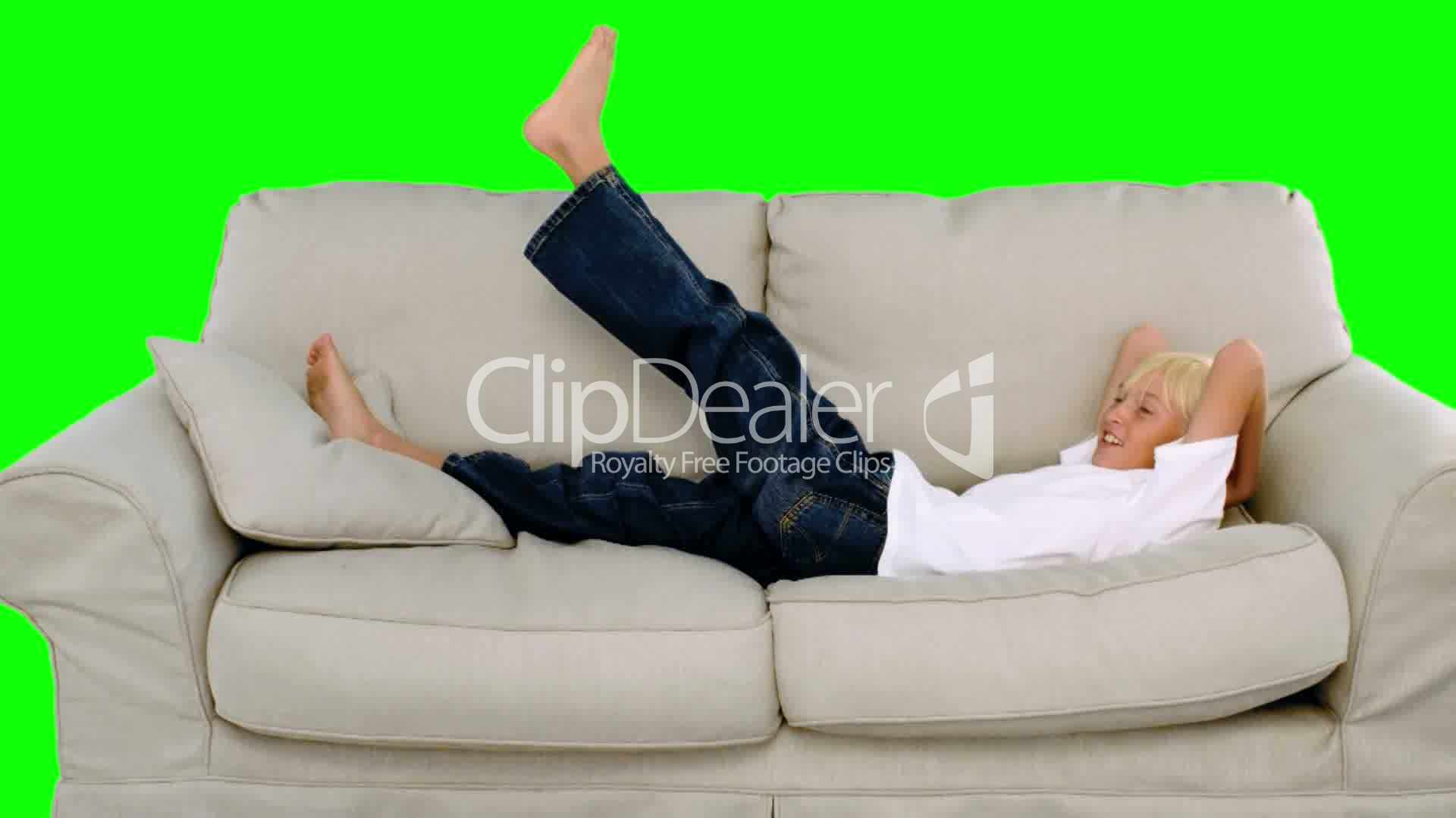 Boy Jumping On The Sofa On Green Screen Royalty Free