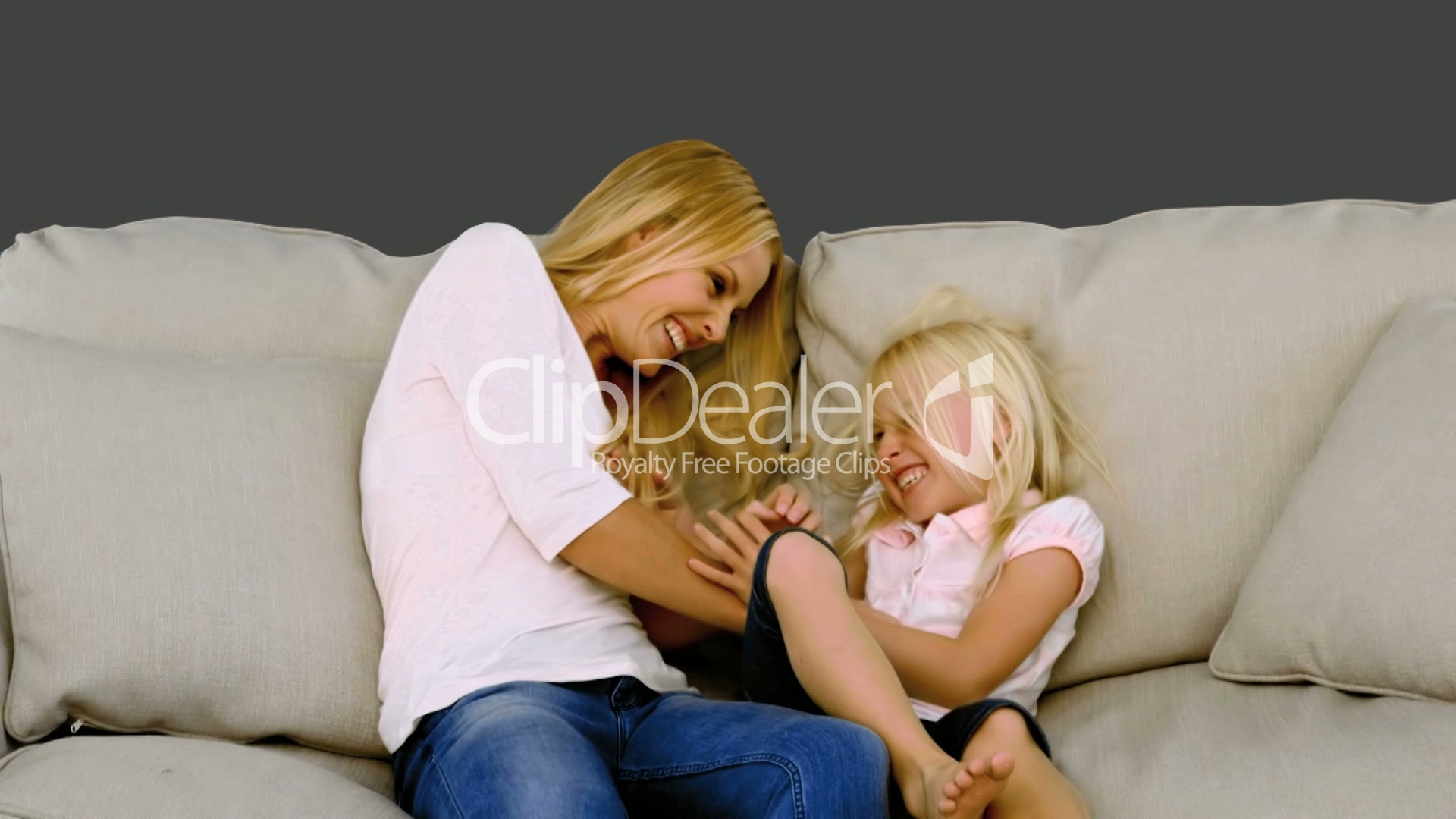 Mother tickling her daughter on sofa: Royalty-free video ...