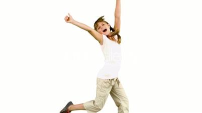 Little girl jumping on white background