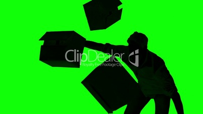 Silhouette of clumsy man dropping boxes on green screen