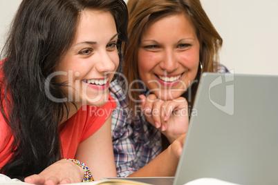 Joyful teens browsing on internet