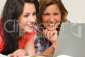 Joyful teens browsing on internet