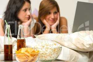 Young girls having slumber party, watching movies