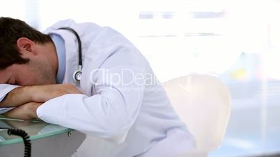 Sleeping doctor woken by his coworker