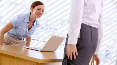 Businesswoman greeting job applicant