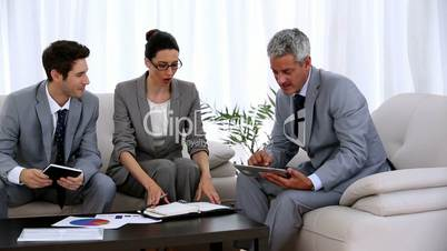 Group of business people looking at a tablet pc