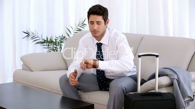 Attractive businessman watching his watch