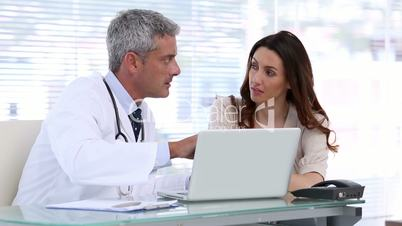 Doctor showing something to patient