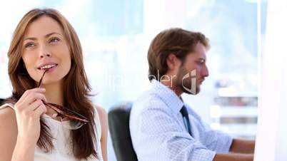 Creative woman thinking with her coworker in the bottom