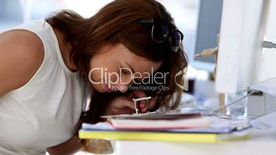 Creative woman looking something with magnifier