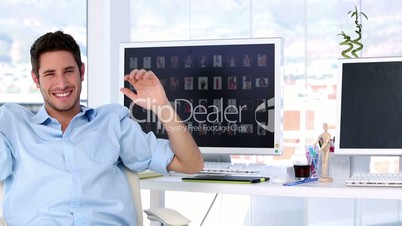 Smiling man in creative office