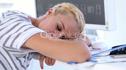 Woman sleeping on a desk