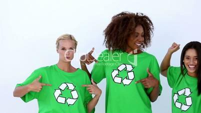 Laughing women with green ecologic t-shirt