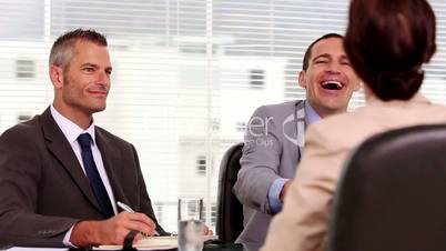 Smiling businessmen shaking hand of a job applicant
