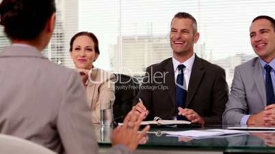 Cheerful job applicant laughing during an interview