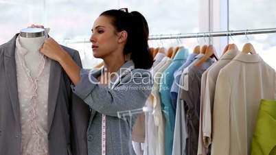 Fashion designer working on a jacket