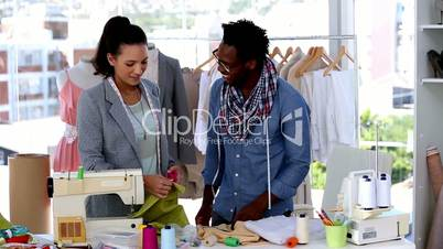 Fashion designers working together with a fabric