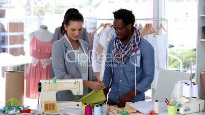 Fashion designers working with a fabric