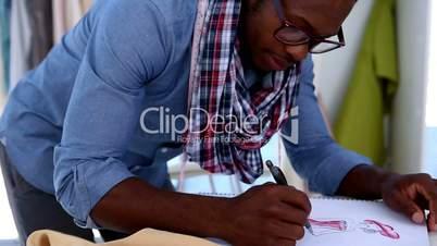 Fashion designer drawing clothes