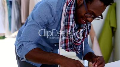 Fashion designer drawing clothes with a pencil